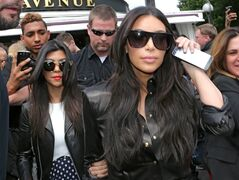 "FILE - In a Thursday, May 22, 2014 file photo, Kim Kardashian, front and Kourtney Kardashian, left, leave at a restaurant in Paris. Kardashian and her friend, Jonathan Cheban, went on rides on the Casino Pier in Seaside Heights on Tuesday, July 8, 2014, and stopped by Kohr's Frozen Custard. Her rep told the Asbury Park Press they were taping segments for the series ""Kourtney & Khole Take the Hamptons.""(AP Photo/Jacques Brinon, File)"