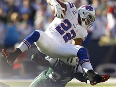 Buffalo Bills's Fred Jackson (22) is tackled by New York Jets' Darrelle Revis (24) during the second quarter of an NFL football game in Orchard Park, N.Y., Sunday, Nov. 6, 2011. (AP Photo/Derek Gee)