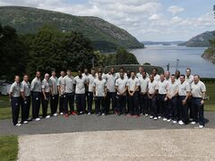 Members of the United States men's national basketball team pose for a photo at Trophy Point overlooking the Hudson River during a tour at the U.S. Military Academy on Monday, Aug. 18, 2014, in West Point, N.Y. The team held an afternoon practice session at the academy. (AP Photo/Mike Groll)