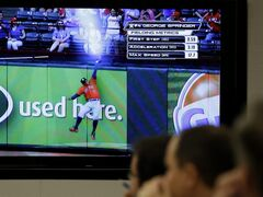 Reporters and Major League Baseball employees watch a demonstration of new statistics made possible by technology upgrades at baseball stadiums during a news conference, Monday, April 20, 2015, in New York. (AP Photo/Seth Wenig)