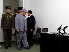 American missionary Kenneth Bae, second from right, arrives to speak to reporters at Pyongyang Friendship Hospital in Pyongyang Monday, Jan. 20, 2014. Bae, 45, who has been jailed in North Korea for more than a year, appealed for the U.S. to do its best to secure his release. (AP Photo/Kim Kwang Hyon)