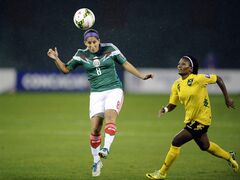 Mexico's Teresa Noyola (8) heads the ball against Jamaica's Donna-Kay Henry (4) during the first half of a CONCACAF soccer match at RFK Stadium, Tuesday, Oct. 21, 2014, in Washington. (AP Photo/Nick Wass)