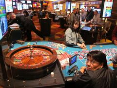 This April 17, 2015 photo shows a roulette dealer counting out chips in a newly renovated section of the casino floor at the Tropicana Casino and Resort in Atlantic City, N.J. The casino is nearing completion of a $50 million renovation. (AP Photo/Wayne Parry)