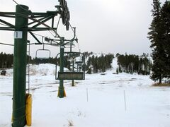 In this Nov. 22, 2014 photo shows a ski lift at Ski Mystic Deer Mountain in Lead, S.D. Ski Mystic Deer Mountain will start welcoming skiers on Dec. 5 for a short time, with a full opening near Christmas. (AP Photo/James Nord)
