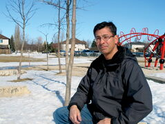 Linden Woods father Mark d'Almeida sits where he hopes will be an outdoor classroom at École Van Walleghem School.