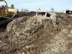 An RCMP photo of the stolen tractor, found in a 15-foot-high manure pile.