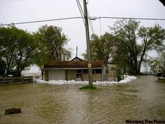 Water from Lake Manitoba overwhelms a Twin Lakes Beach property in the RM of St. Laurent.