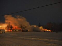 Fire ravages a workshop located near the elementary school in West St. Paul Tuesday.