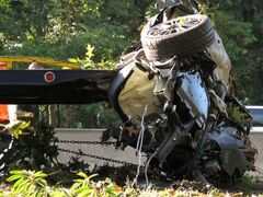 FILE - This Oct. 8, 2012 file photo shows the wrecked Subaru Impreza in which four people died as it is loaded onto a flatbed truck on the Southern State Parkway in West Hempstead, N.Y., after and early-morning accident. At the wheel was a New York teenager, Joseph Beer, who had smoked about $20 worth of marijuana, before getting into the car with four friends, and driving over 100 mph before crashing into trees with such force that it split the car in half. As states liberalize their marijuana laws, public officials and safety advocates worry that more drivers high on pot will lead to a spike in traffic deaths. Researchers who have studied the issue, though, are divided over whether toking before taking the wheel in fact leads to more accidents. (AP Photo/Frank Eltman, File)