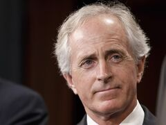 FILE - This April 30, 2014 file photo shows Sen. Bob Corker, R-Tenn. on Capitol Hill in Washington. Two senators proposed Wednesday to raise federal gasoline and diesel taxes for the first time in more than two decades as Congress struggles with how to pay for highway and transit programs. Sen. Chris Murphy, a Connecticut Democrat, and Corker, a Tennessee Republican, pitched their plan as a bipartisan solution to replenish the federal Highway Trust Fund. That fund is forecast to go broke in late August. (AP Photo, File)
