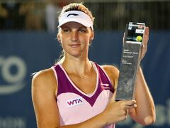 Karolina Pliskova of the Czech Republic poses with her trophy after winning her final match against Bethanie Mattek-Sands of the United States at the WTA Malaysian Open tennis tournament in Kuala Lumpur, Malaysia, Sunday, March 3, 2013. (AP Photo/Lai Seng Sin)