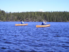 As Zeilig canoed  the placid waters of Haggart Lake, he composed a poem about the rhythmic experience.