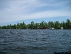 A view of the cottages lining Moose Lake on May 29, 2010.