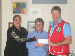 East St. Paul Lion Ward McVey presents a cheque to Canadian Deaf Blind Association director of operations Kim Knowles and team leader Kelly Kirby.