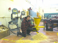 Student Patrick Ryczko says working on Nelson McIntyre's sawdust recovery device has helped him realize how important subjects such as math and English are.