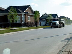 Large trucks sometimes speed down the residential streets of Waverley West.