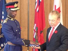 City of Winnipeg CAO Phil Sheegl swears in Devon Clunis at city hall Friday.
