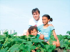Paul Bilodeau and his grandkids have some fun in the pumpkin patch.