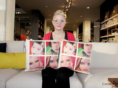 "Sam Jarmasz with two of the pillows which feature her artwork ""World Beauty."" Jarmasz's piece was selected as one of nine works by Canadian artists to be featured on products by Canadian furniture company EQ3."