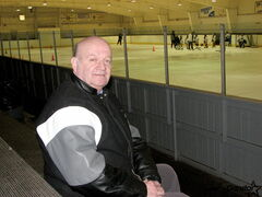 West Kildonan Memorial Arena president Bryan Huen sits on the arena's bleachers, which need upgrading, along with a number of other areas in the facility.