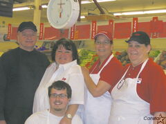 Main Street IGA employees Al Dawydiuk, Kathy Shore, Sandra Williams, Angie Paul, with Derrick Martin in front.