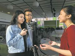 Maples Collegiate students (l-r) Kathy Tran, Gaberiel Ople and Kayla Manalo work on a film for the 7 Oaks Student Film Festival.
