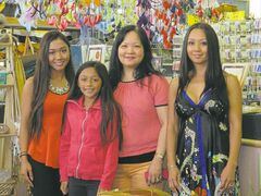 Cathy Mukai, (far right) poses at the Winnipeg Trading Post on Main Street with her mother, Rose (second from right) and Cathy's two daughters.