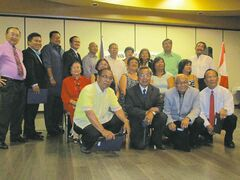 The newly inducted officers of the Pangasinan Group of Manitoba,  led by PGM president Reynaldo Cruz (sixth from left) with the inducting officer, past president Rowena Oquendo (seated, fourth from left, second row).