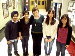 Left to right: Harjas Kirad, Monika Sharma, Lacey Collins (teacher), Neeko Tang, and Maria Miranda reflect on the opportunities and challenges faced through Sisler High School's EAL program.