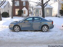 The victim's blue-grey 2006 Pontiac Grand Prix.