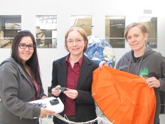 A team of students and staff at the University of Winnipeg are launching a high-altitude balloon on April 24 to collect atmospheric data and video footage in conjunction with science institutes around the country. Pictured, from left, are key project contributors Kimberly Thomson, Tabitha Wood and Adrienne Ducharme.