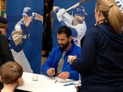 Toronto Blue Jay Jose Bautista signs autographs at Polo Park mall Sunday. Thousands of fans waited to see the slugger.