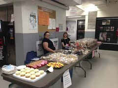 St. Vital Y Neighbours Group members Lynda Nicol and Pam Doerkson waiting for customers at the bake table at the group's last sale in the fall.