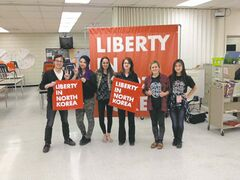 April 22, 2015 -Grade 9 students at Kildonan East are currently learning about democracy. Students (left to right) Hayden Maines, Kaleigh Soldier, Destiny Gill, and Jessica Genaille learned about the plight of North Korea from Alyssa McClearnan and Elaine Chiu of NGO Liberty in North Korean.