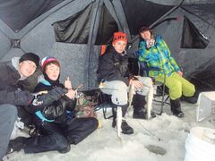 Jan. 8, 2015 - Ethan Shuttleworth, Zachary Bennett, Hudson Wall, and Ryan Porio of River East Collegiate enjoying the shelter from the wind during the grade 9 outdoor education ice fishing trip to Lockport, Man.