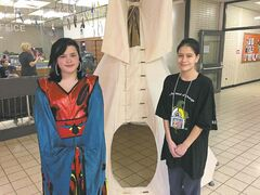 River East-Transcona School Division students Maeres Kematch, Grade 8 (left), and Michaela Robertson, Grade 12, take part in the RETSD Aboriginal Academic Achievement powwow at Chief Peguis Junior High on April 22. (SHELDON BIRNIE/CANSTAR COMMUNITY NEWS/THE HERALD)
