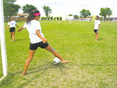 From left: Mya Lee, Cassie Nazeravich and Nicole Davis enjoy a quick soccer practice in Southdale days before leaving for Calgary to represent Manitoba in an U-13 invitiational tournament this week.