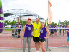 From left to right: Volunteer and student Graeme Riley, runner and teacher Dean Favoni. and volunteer and student Amy Savage. at the finish line of last weekend's Manitoba Marathon.