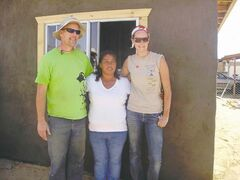 Allan Tiel and daughter Andrea are shown with a woman for whom they built a home in Mexico in 2010.