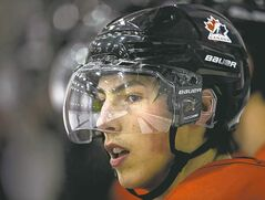 Team Canada captain Ryan Nugent-Hopkins looks up ice from the bench during practice at the IIHF World Junior Championships in Ufa, Russia on Thursday, Dec. 27, 2012. THE CANADIAN PRESS/Nathan Denette