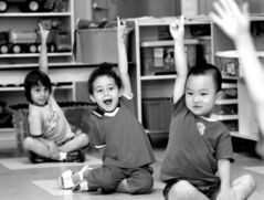 Children raise their hands for ice cream at a daycare centre in Montreal.