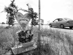 Highway memorial and cross mark the spot where Crystal Taman was killed in February 2005.