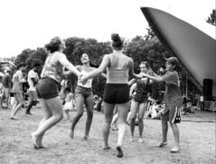 Friends dance together at the Winnipeg Folk Festival at Birds Hill Provincial Park last July.