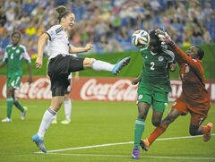 Nigerian goalkeeper Sandra Chiichii thwarts Germany' Kathrin Schermuly during second-half action in the FIFA under-20 Women's World Cup final on Sunday.