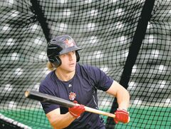 Winnipeg Goldeye Brock Bond framed in the batting cage web up early in Monday�s pre-playoff practice before rain shut the workout down. See Melissa Marten�s story. Sept, 2, 2014- (Phil Hossack / Winnipeg Free Press)