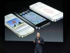 Apple CEO Tim Cook introduces the iPhone 5S and 5C in Cupertino, Calif., Tuesday.