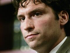 NHL player Steve Moore listens to a question during a news conference in Toronto in a Dec.23, 2004 file photo. Moore says the 10 years since his NHL career came to an abrupt end have been very difficult, but he is glad to no longer be burdened by an unresolved legal case. THE CANADIAN PRESS/Adrian Wyld