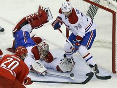 Carolina Hurricanes' Riley Nash (20) tries to score as Montreal Canadiens Andrei Markov (79), of Russia, and goalie Carey Price defend during the third period of an NHL hockey game in Raleigh, N.C., Saturday, Feb. 8, 2014. The Canadiens have signed defenceman Markov to a US$17.25-million, three-year deal.THE CANADIAN PRESS/ AP/Gerry Broome
