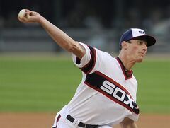Chicago White Sox starting pitcher Chris Bassitt delivers in the first inning of the second game of a baseball doubleheader against the Detroit Tigers in Chicago on Saturday, Aug. 30, 2014. (AP Photo/Matt Marton)