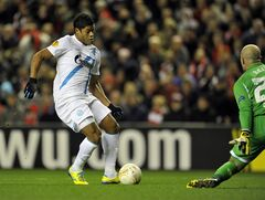 Zenit St Petersburg's Hulk left, scores the first goal for his side against Liverpool during their Europa League round of 32 second leg soccer match at Anfield in Liverpool, England, Thursday Feb. 21, 2013. (AP Photo/Clint Hughes)